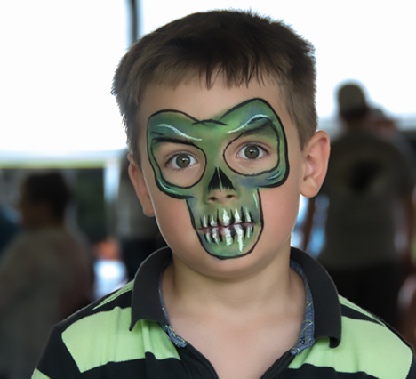 boy with hobgoblin face paint