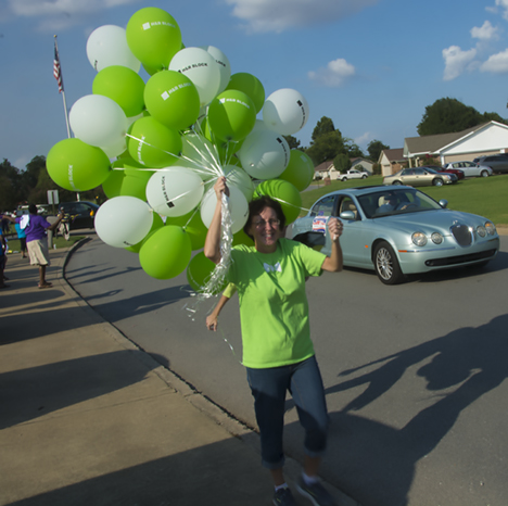 Woman with balloons in Dumas AR parade