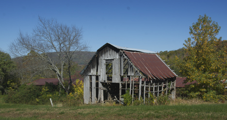 Old leaning barn side view