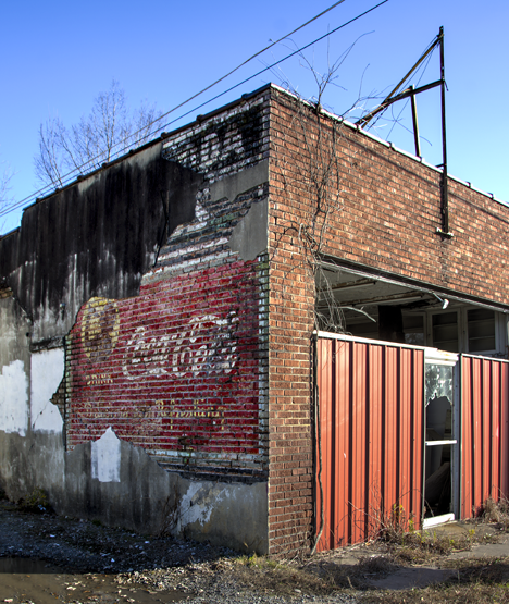 Old Coca Cola sign on vacant drug store wall