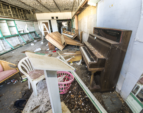 Old piano in abandoned drug store