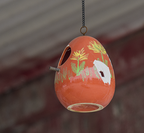 orange ceramic birdhouse