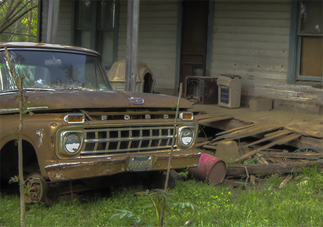 Old house and abandoned pickup