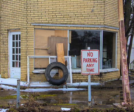 No parking sign at closed business