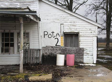 Pota 2 sign on building