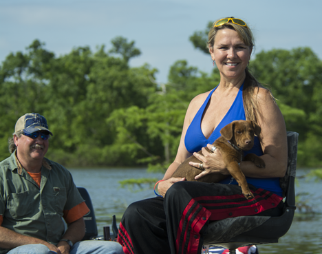 Man, woman and dog in boat