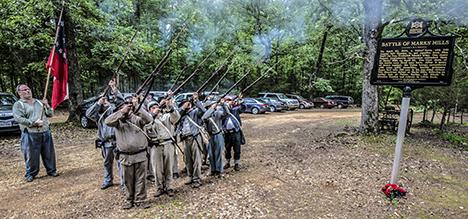 First Arkansas Infantry reenacators firing a salute