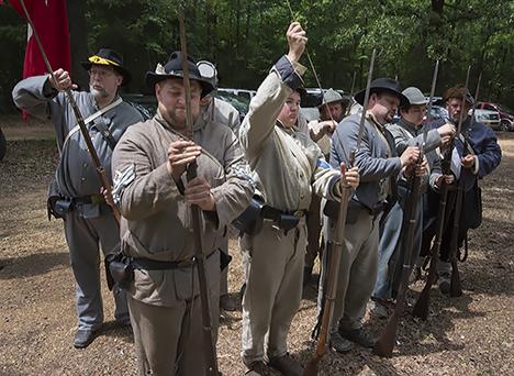 Civil war reenactors reload after firing a salute