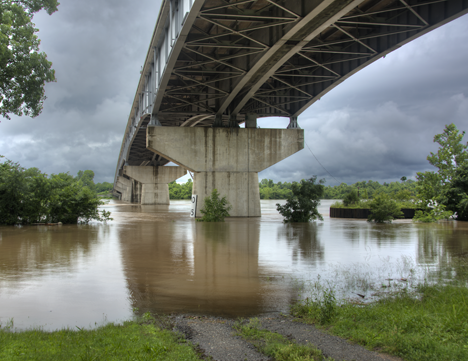 bridge over flooded river