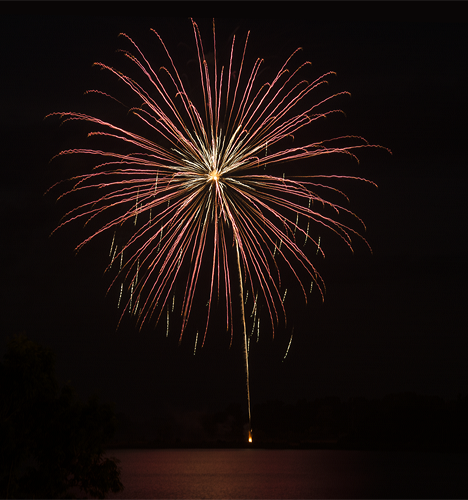 fireworks burst over Saracen Lake
