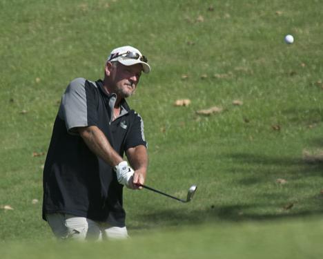 golfer making approach shot