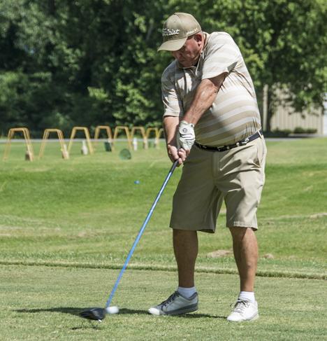 golfer making tee shot