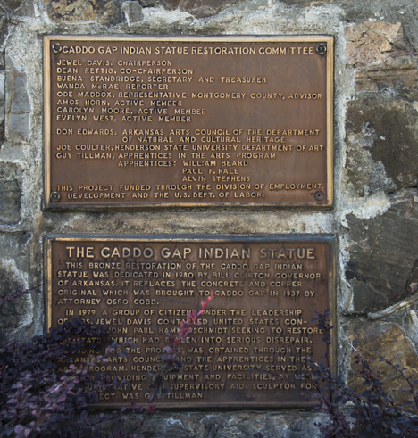 Bronze plaques on statue base