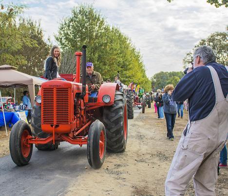 Joe Dempsey photographing tractor