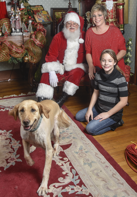 Santa, mother, daughter, and Maxie the dog