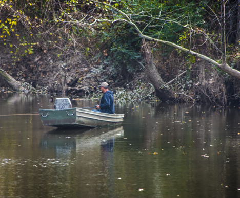 Man fishing on Bayou Bartholomew