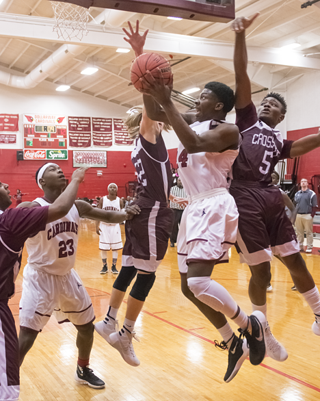 Dollarway HIgh School basketball player makes his move to the hoop.