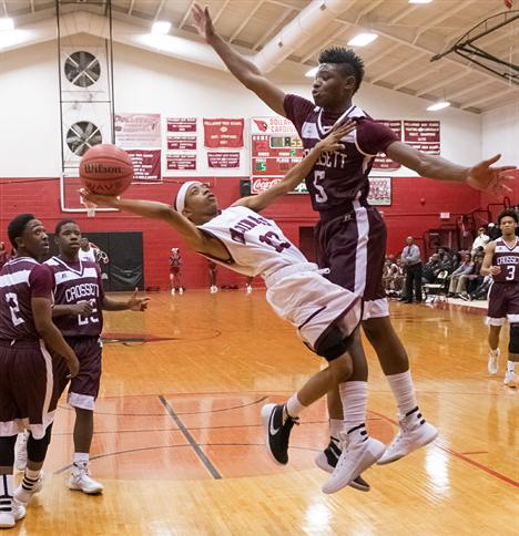 Basketball player makes as fall away shot
