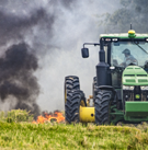 Tractor setting fire to field